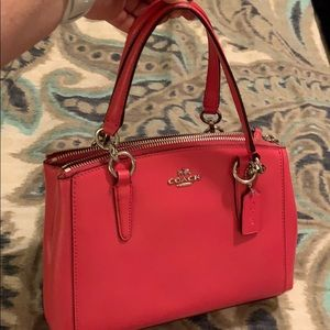 Hot pink Coach purse with matching wallet
